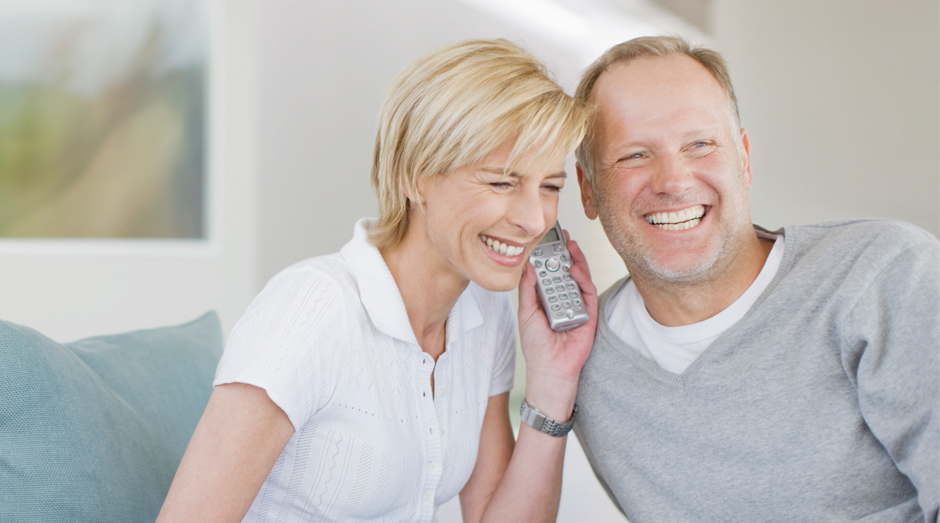Couple making a long distance phone call