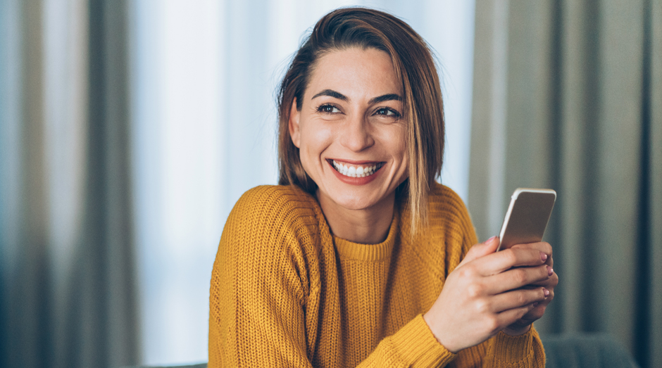 Happy person with a smartphone